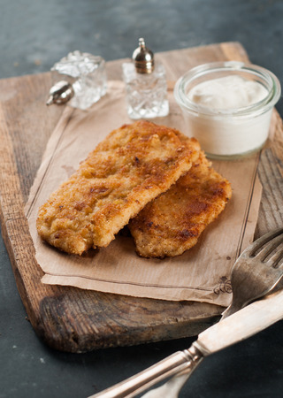 Chicken or pork schnitzel with sauce, selective focus photo