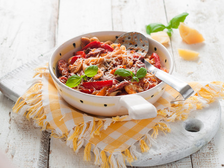 pasta: Pasta with tomato sauce and pepper, selective focus Stock Photo