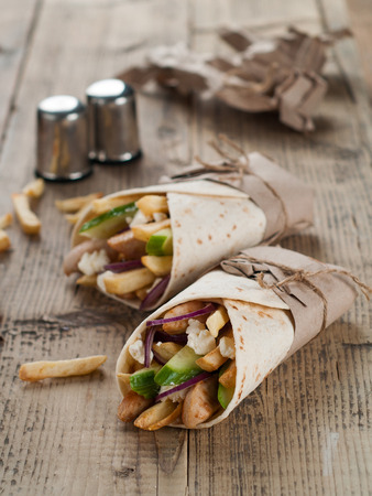 burrito: Fresh tortilla wraps with grilled chicken,vegetables and potato, selective focus Stock Photo