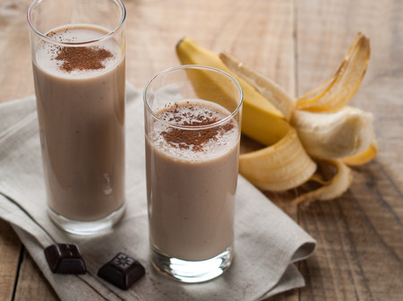 Chocolate and banana smoothie (milkshake) in glass, selective focus