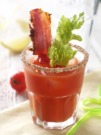 Bloody mary cocktail with bacon and celery, selective focus