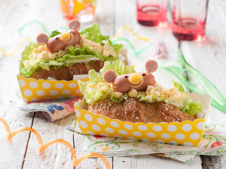 hotdog sandwiches: Delicious sandwiches with sausage like a bear for kids party, selective focus