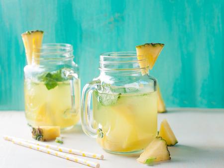 Pineapple lemonade with lemon and mint, selective focus