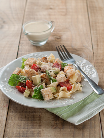 pasta salad: Pasta salad with chicken, tomato, cheese and sauce, selective focus