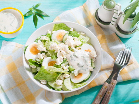 heathy: Fresh salad with egg and cheese, selective focus