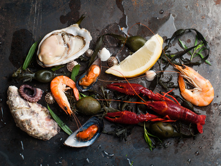 seafood dinner: Delicious fresh seafood on dark vintage background, selective focus