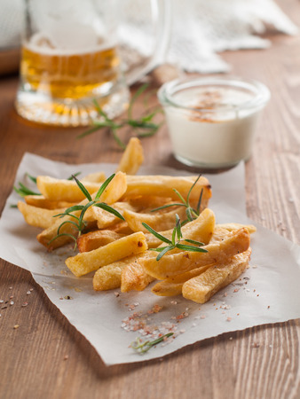 frites: Roasted potato with sauce and spices, selective focus