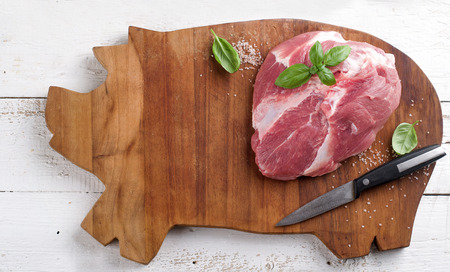 Raw fresh meat on wooden board, selective focus