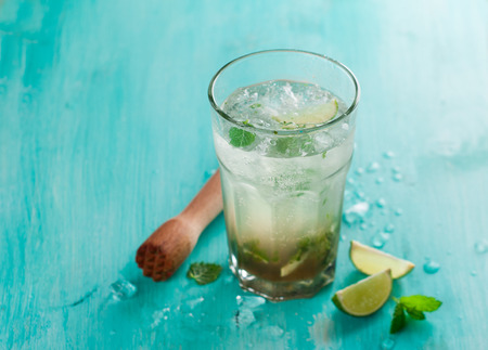 Mojito drink or lemonade with lime and mint, selective focus Stock Photo