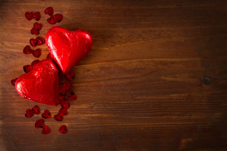 Chocolate hearts on wooden board, Valentines Day background, selective focus Stock Photo