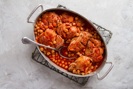 ragout: Chicken stew or ragout with nuts, carrot and tomato sauce, selective focus