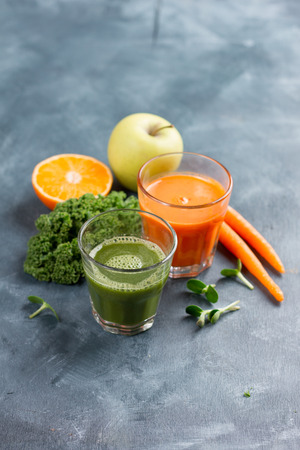 Fresh fruit and vegetable juice in the glass for detox or healthy lifestyle, selective focus