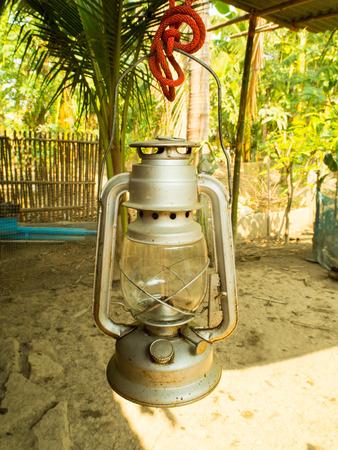 hurricane lamp: Old kerosene lantern burning with bright flame