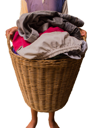 household chore: Overflowing laundry basket. Household chore concept on white background Stock Photo