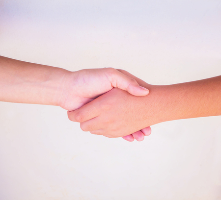 businessteam: Business handshake isolated on white, Closeup of people shaking hands on white background