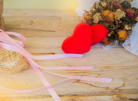 Red heart on wooden background, Valentines day ,Two red heart pendant on a background of wood.