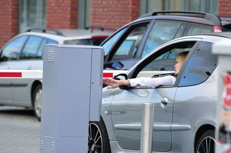 Taking a parking card at the entrance