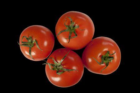 Tomato isolated on a black background Stock Photo