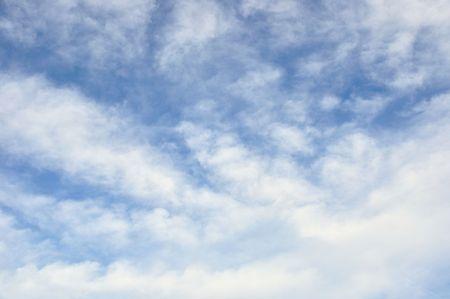 deep blue sky with sleepy clouds