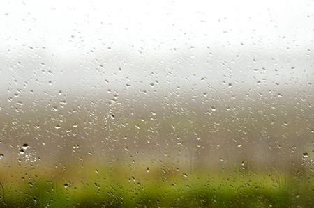 Misty window on a rainy day in november