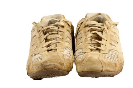 Pair of old sneakers isolated on a white background Stock Photo - 8259125