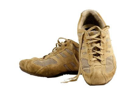 Pair of old sneakers isolated on a white background Stock Photo - 8259124