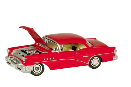 old red classic car with open hood