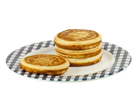 stack of pancakes on a plate isolated on a white background