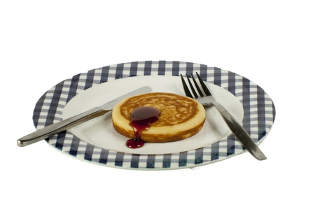 single pancake on a plate isolated on a white background