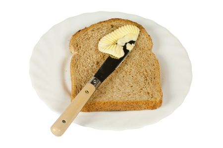 Slice of bread on a white plate photo
