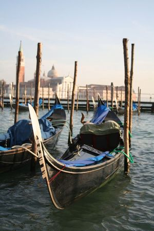 Gondola parking in Venice, Italy. Building on the background.