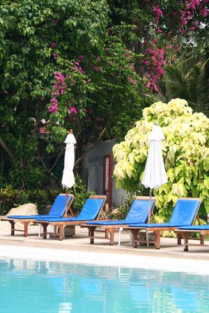Chaise-longues near the swimming pool