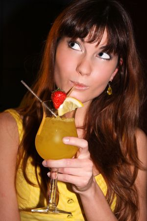 This is a portrait of a girl with a cocktail. photo