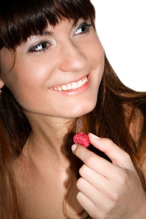 It is a portrait of smiling girl with a raspberry in her hand