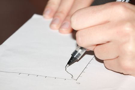 This is a picture of a graph plotted on the paper. Stock Photo