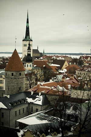 This is a photo of Old Town in Tallinn, Estonia. There are many buildings, the weather is gloomy. Stock Photo