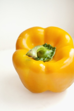 Picture of a yellow pepper against white background. Stock Photo