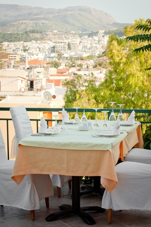 A picture of a table on a summer terrace of a restaurant. Stock Photo - 10044225