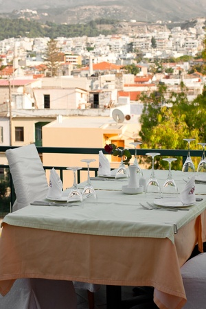 A picture of a table on a summer terrace of a restaurant.
