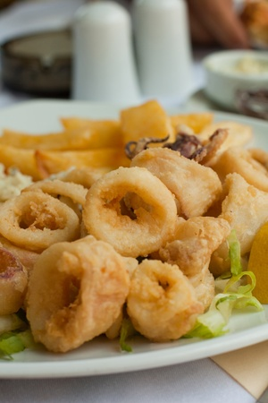 Fried calamari with vegetables on the plate Stock Photo
