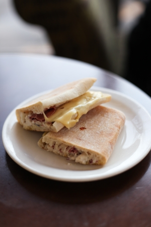 Picture of two fresh sandwiches with ham and cheese on a plate  photo