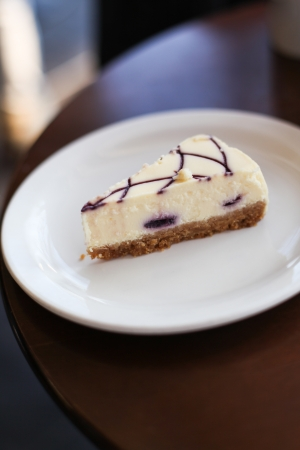 A piece of white vanilla cheesecake on a plate  photo