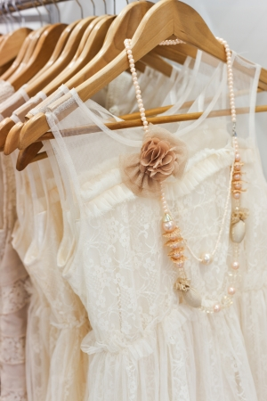 A picture of beautiful lace white dress on the hanger   photo