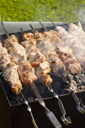 Picture of meat cooking on barbeque grill Stock Photo