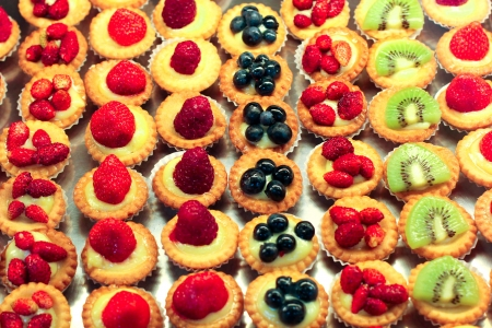 Selection of beautiful fruit mini cakes. Stock Photo