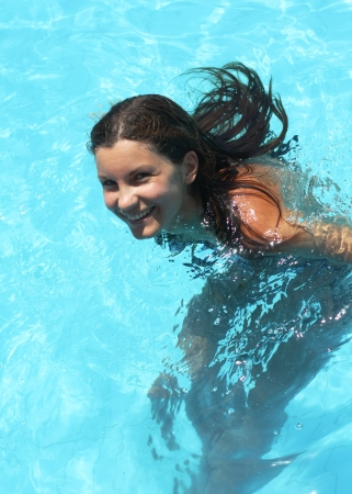 Smiling young woman in the swimming pool