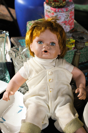 playing the market: Picture of a doll in the shop