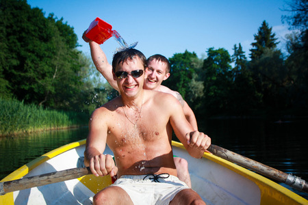 Picture of two friends laughing and having fun in the boat