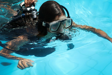 Picture of a girl learning to dive with an instructor