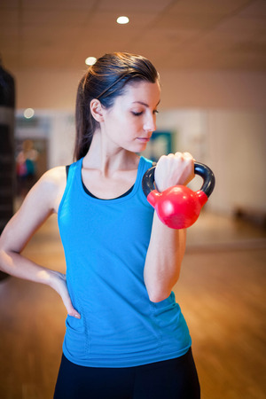Photo of a girl working out in the gym. Stock Photo